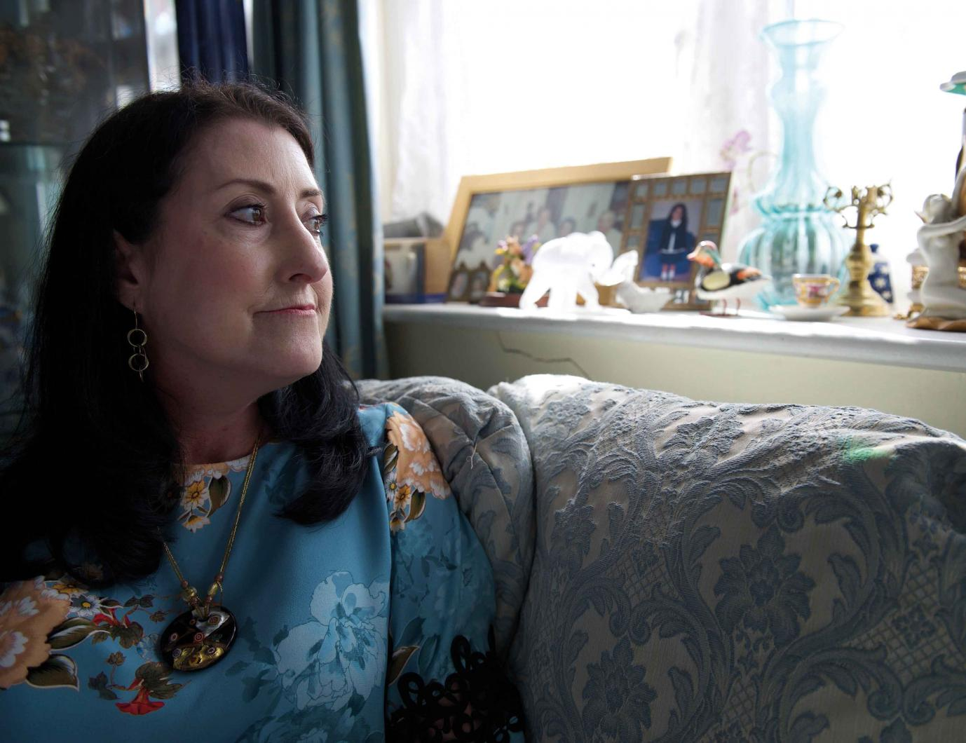 Woman with scleroderma looking out of the window