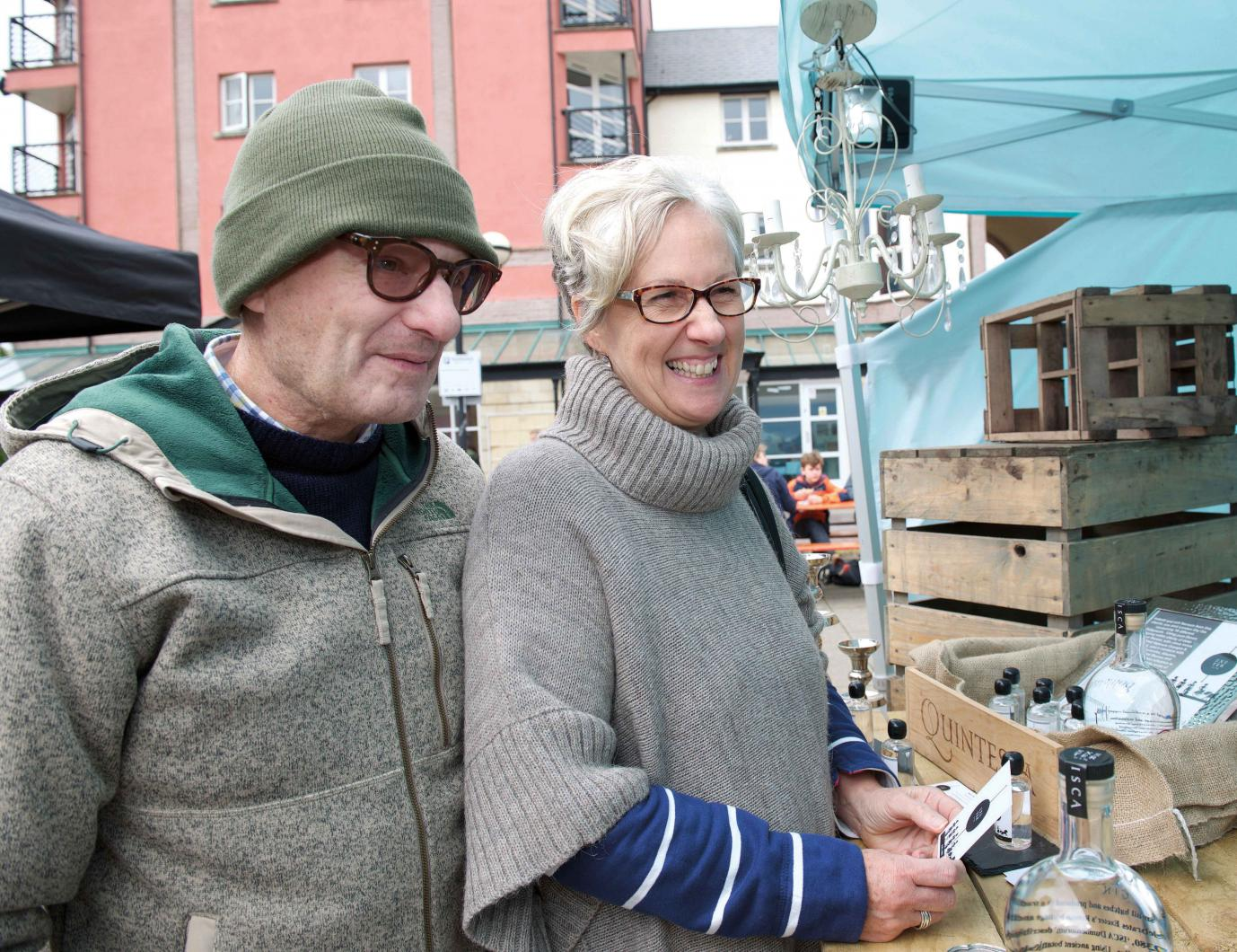 Man with scleroderma with his wife at a market