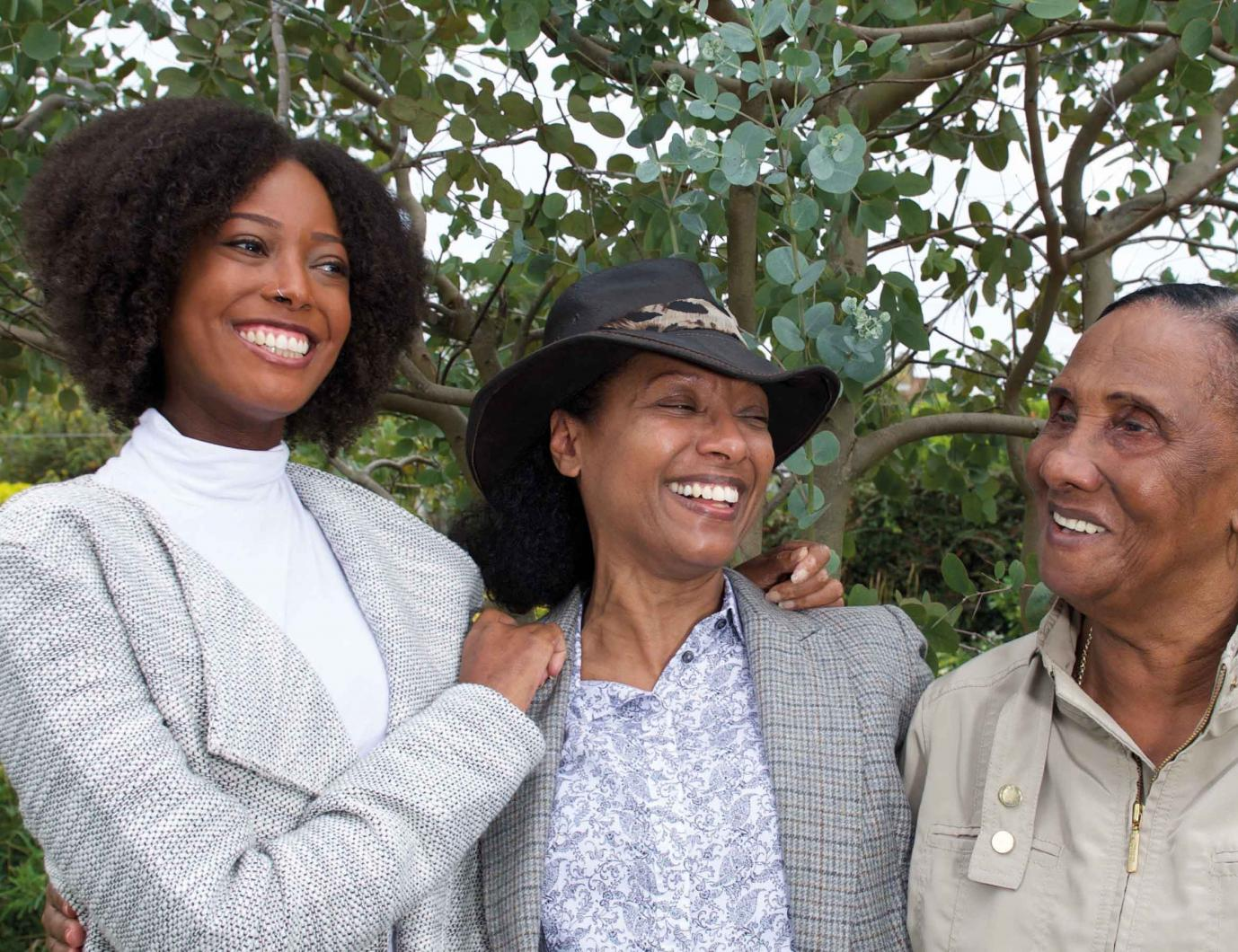 Woman with scleroderma looking very happy with family
