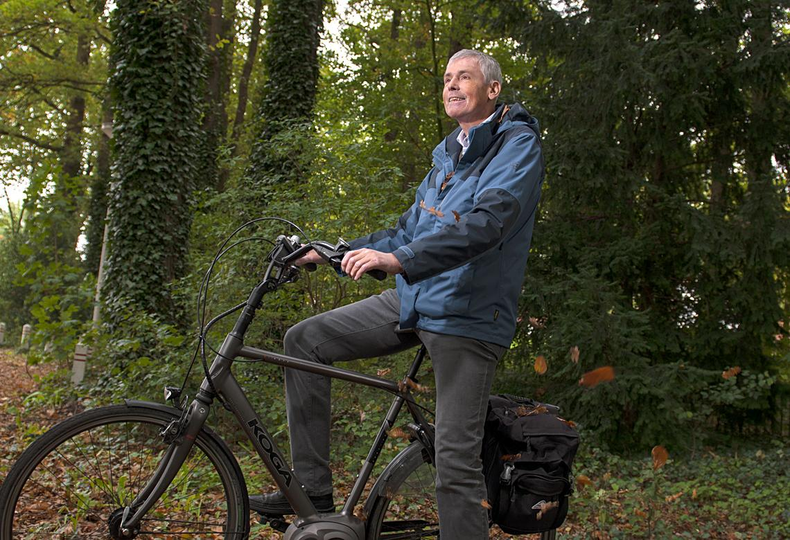 Joep with his bicycle outdoors