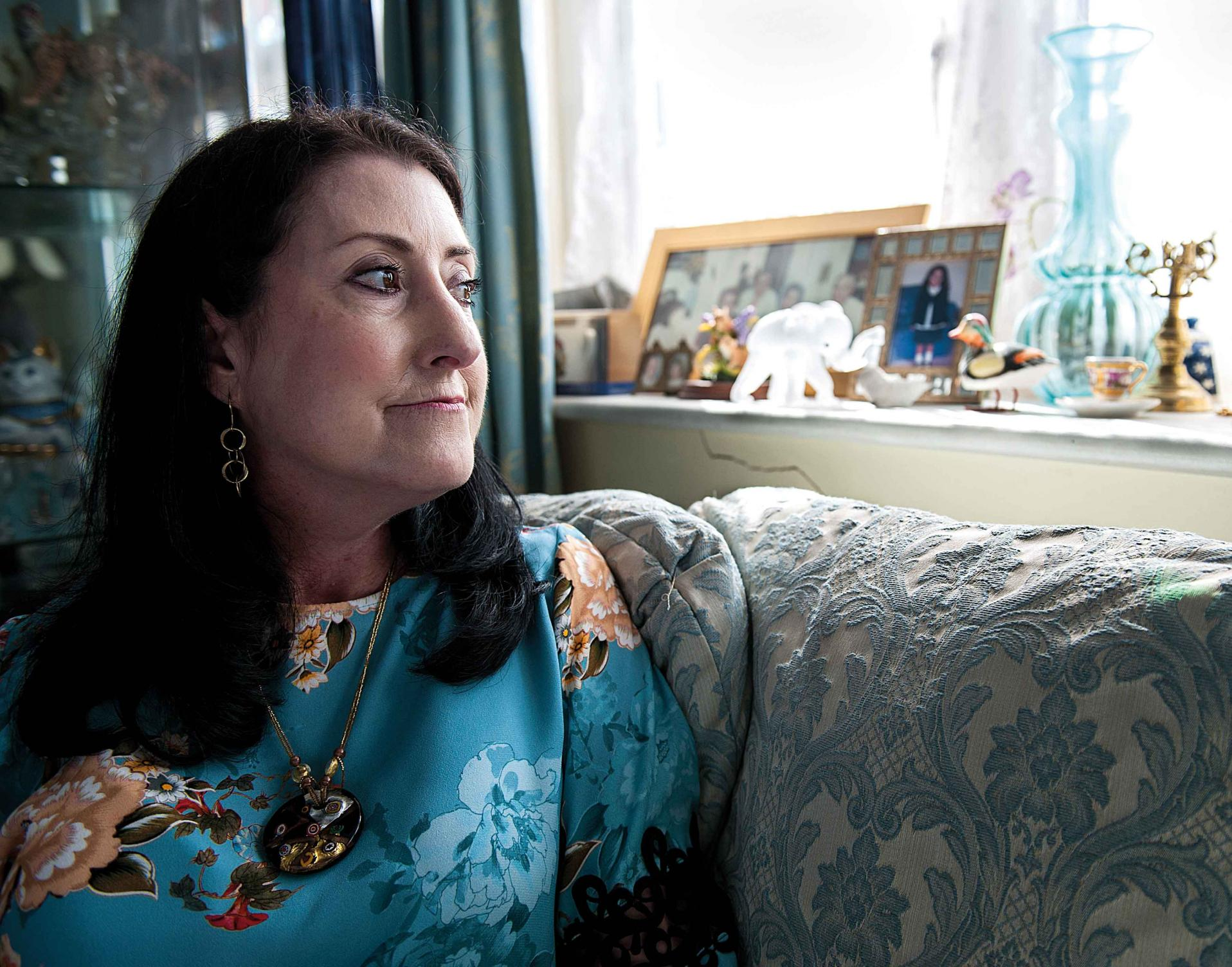 Woman with scleroderma looking out of window