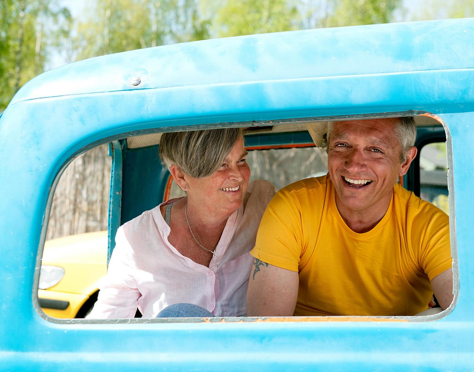 Juan and Monica in a vehicle