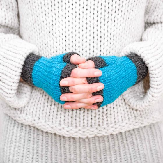 Hands with blue fingerless gloves