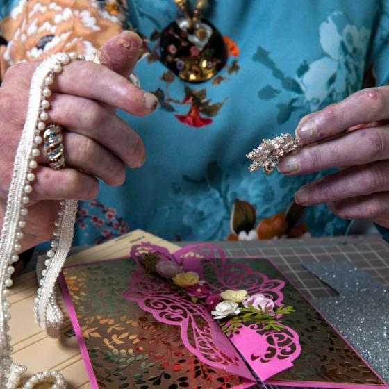 Woman creating flower and paper decoration